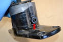 Use a 24mm socket and remove the cap nut on the front of the housing (red arrow).