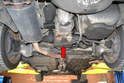 You can also lift the rear of the vehicle using the transaxle (red arrow).
