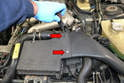 Remove the two flathead screws connecting the air box to intake tube (red arrows).