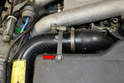 There is a metal clamp that wraps from the top of the air box over the turbo air pipe and connects to the bottom of the air box lid.