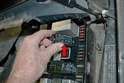Locate and remove the fuel pump relay (red arrow).