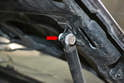 Hood shock: You can find a surprising amount of different hardware that has been installed over the years (red arrow).