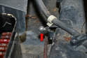 Hood shock: Before installing the new shock make sure to clean and lubricate the ball mount (red arrow).