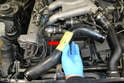 Remove the pipe from the engine (red arrow).