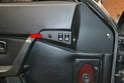 The switch plate on the driver's side contains the switch for the mirror and both windows (red arrow).