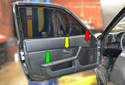 There are three components on or in the panel that need to be removed -- the window and mirror switch (red arrow), the handle trim piece (yellow arrow) and the armrest and map pocket (green arrow).