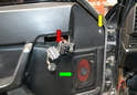 With the switches free of the panel (red arrow), you will want to use a Philips head screwdriver and remove the single screw (yellow arrow).
