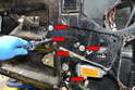 Use a 10mm socket and remove the five bolts holding the regulator and motor in place (red arrows).