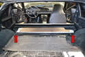 Rear Seat - To remove the rear seats, start with the seat folded into the down position and pull back the carpet on both the hatch and the rear upper seat.