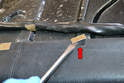 Rear Seat -Use a flathead screwdriver and carefully pry up and back the series of clips (red arrow) making sure not to damage the leather as you go.