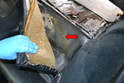 Rear Seat: Carefully pull the seat backing away from the chassis separating the glue as you go (red arrow).