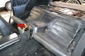 Rear Seat: Separate the lower seat cushion from the chassis and slip the leather out from under the carpet (red arrow).