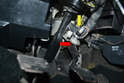 Locate the brake light switch mounted to the bracket in front of the brake pedal.