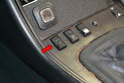 The normal operation of the sunroof is run by the single sunroof switch on the center console (red arrow).