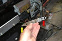 Remove the two plastic wingnuts and the tool from the rail.