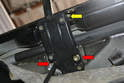 Remove the two 5mm Allen bolts (red arrows) and the single 4mm (yellow arrow) top bolt from each lifting assembly.