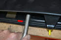 Install the new seal beginning at the center front of the panel under the center latch (yellow arrow).