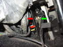 Pry the spring clip off the shaft (red arrow) and then slide the adjusting block off of the shaft on the pedal (green arrow).