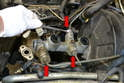 Use the 11mm flared nut wrench and remove the three brake lines (red arrows).