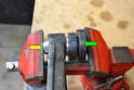 You are going to use a press or vice to compact the ball joint together so you can insert the retaining ring into the groove in the control arm.