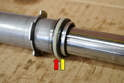 Make sure to reinstall the Teflon bushing on the other end of the sleeve (red arrow) and replace the rubber O-ring (yellow arrow).