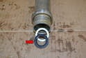 The new bushing and seal must be installed from the long end of the tube.