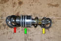 The pinion has a series of four rubber and Teflon O-rings that you are going to replace (green arrow).