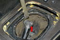 Remove the shift knob cover and separate the knob linkage from the shift shaft: On our car it was a circlip (red arrow).