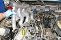 If you have a single cross over pipe you will need to remove the intake manifold.