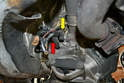 Disconnect the wiring harness for the starter motor from the bell housing and slide the wires out of the way.