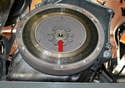 The rear main seal is located behind the flywheel (red arrow); this means you will need to remove the flywheel to change the seal.