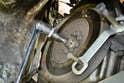 Making sure that the socket is well seated, break each bolt loose in a crisscross pattern.