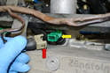Use a small flathead screwdriver or pick and release the wire clips on the wiring harness (red arrow).