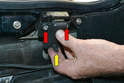 To replace the latch mechanism or the rubber grommet you will need to remove it from the chassis.