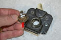 Remove the old grommet (red arrow) from the latch making sure you get it all out and clean.