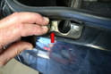 Check the condition of the latch post plate by lifting up the rubber gasket over the latch plate.