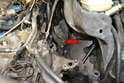 Do not forget to install a 13mm bolt into the empty engine plug to help hold the heat shield (red arrow).