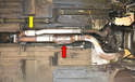 The stock Porsche 951 down pipe has two catalytic convertors: one for the exhaust gases (red arrow) and a small one for the gases from the wastegate (yellow arrow).