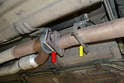 Next, remove the fasteners that join the Cat pipe to the exhaust pipe (red arrow).