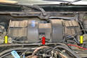 With the cover off you will see the blower motor housing (red arrow) that has a metal filter on each end (yellow arrows).