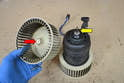 If you are transferring the old fans to the new motor or you just want to remove the fans to clean them, use an 8mm socket and remove the single nut from each fan (red arrow) and pull the fan off of the motor shaft (yellow arrow).