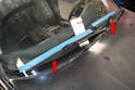 Mark the position of the wiper arms and blades before removing them with masking or painter's tape (red arrows).