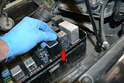 Check with the fuse and relay list and diagram located under the lid and remove the DME relay (red arrow).