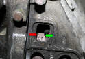 As you are rotating the engine clockwise you will first see the letters OT on the flywheel.