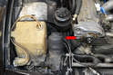 The coil is located behind the headlight motor and should have a protective cover over it (red arrow).