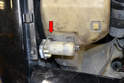Windshield Pump- There is a plastic clip (red arrow) that helps hold the pump in place on the bracket and reservoir.