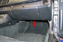The factory alarm is located in the passenger footwell behind the floorboard and up above the DME (red arrow).