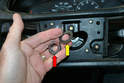 Remove the 24mm nut (red arrow) and the large wavy washer (yellow arrow) from the steering shaft.