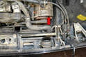 The switch is located below the upper radiator coolant hose (red arrow).
