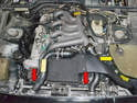 The crossover pipe (red arrows) is located below the air box and turbo to intercooler and intercooler to intake manifold pipe.